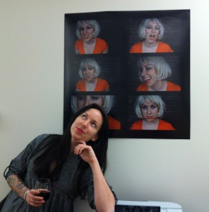 Artist Andrea McGinty poses in front of one of her performance pieces.